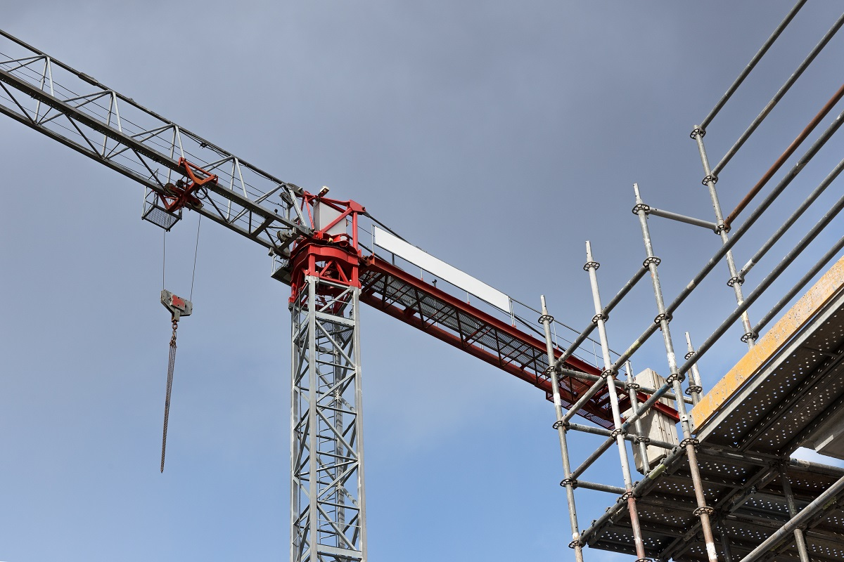 Crane and scaffold on building construction